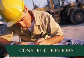 Construction Worker Reading Blueprint - Construction Recruiting Company
